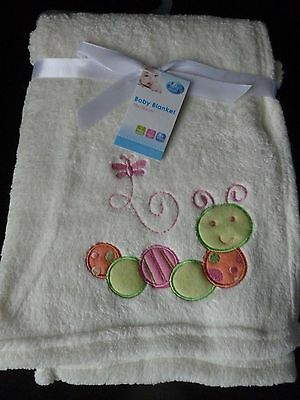 FIRST STEPS CREAM SUPER SOFT FLEECY BABY BLANKET with EMBROIDERED MOTIFS.