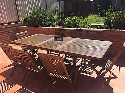 Solid Outdoor Table Teak outdoor dining setting.