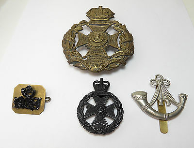 Four Vintage Military Cap Badges Army