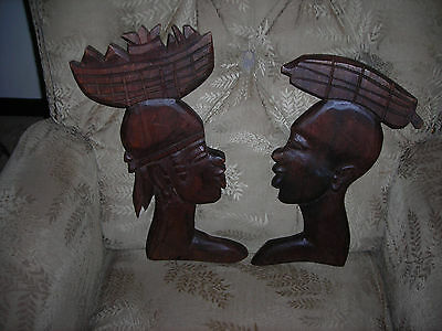 Carved wall hangings( 2), African ,thick,well detailed silhouettes,