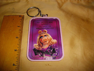 miss piggy muppets key chain 1981 my needs are simple my wants are expensive