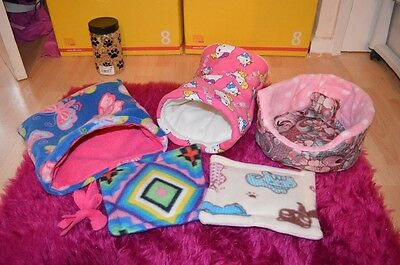 snuggle sack, tunnel & 2 lap pads, cuddle cup & free toy for Guinea pigs