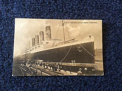 1908, R.M.S. LUSITANIA IN DRY DOCK.LIVERPOOL. people watching.