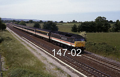 Original 35mm colour slide of 47847 at Charlton with M'chester train (147-02)