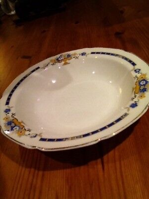 Vintage Grindley bowl patterned with urns and blue flowers