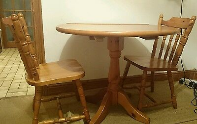 Pine Round Dining Table and Two Chairs
