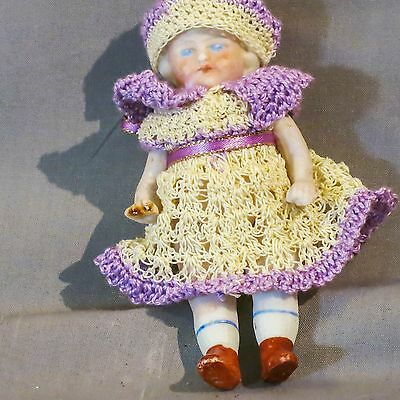 Antique German 41/4 inch All Bisque Doll 9770 in crocheted dress and cap