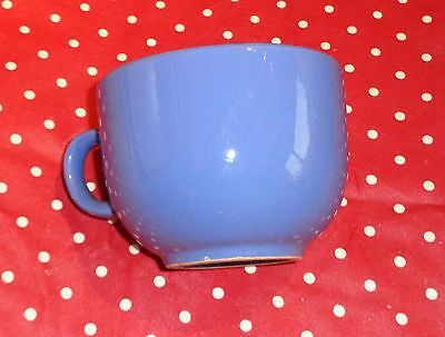 Large bright blue ceramic cup holds one pint