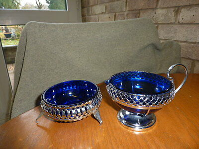 blue glass sugar bowl and jug in silver metal caseing