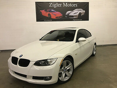 2009 BMW 3-Series Base Coupe 2-Door 2009 BMW 335i Coupe Sport,White,Low miles,Clean Carfax immaculate