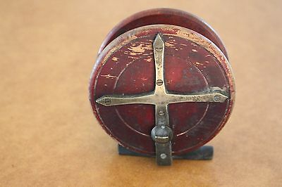 Vintage brass and timber fishing reel