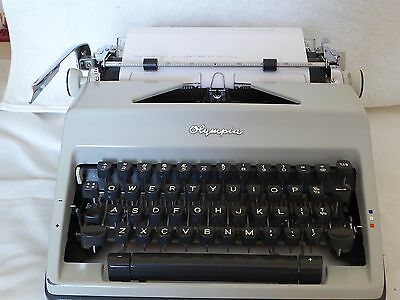 Vintage Olympia Portable Typewriter With Carry Case & Spare Ribbons