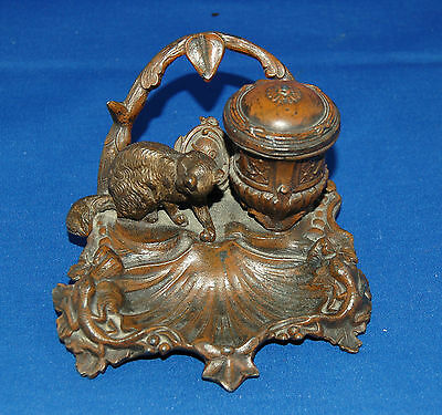 An characterful victorian bronzed metal inkwell with cat figure and glass liner