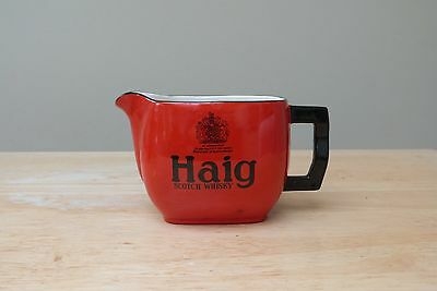 Haig, White Horse, and Hewitt's whisky jugs