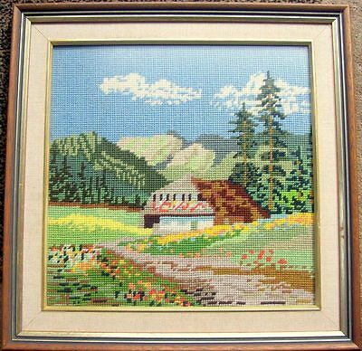 Nicely framed tapestry of an house with a hilly background