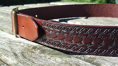 Hand made leather belt with arrow design for traditional archery