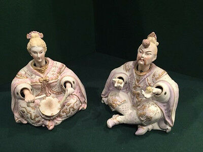 A PAIR of ORNATE ORIENTAL PORCELAIN NODDERS