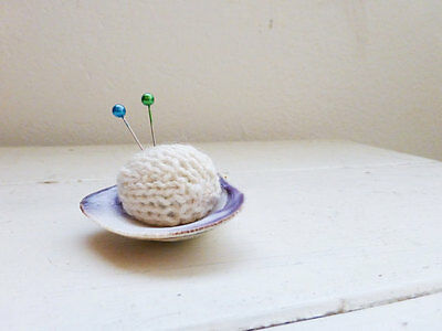 Knit clamshell pincushion in white