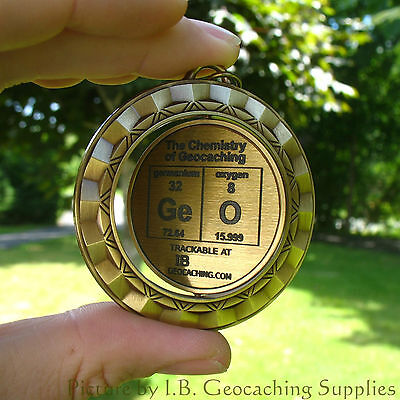 """TRACKABLE GeO Spinner - The Chemistry of Geocaching (2.25"""", Ant. Gold Colour)"""