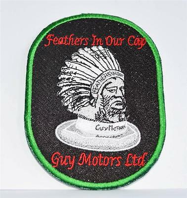 Embroidered cloth badge -   ' Guy Motors ' feathers in our cap .
