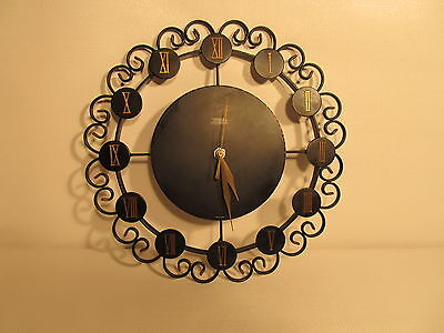 Iron decor wall clock made in  Germany, battery operated. (ref 479)