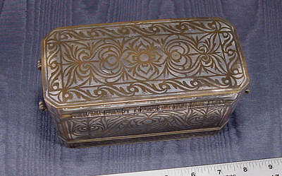 A silver inlaid, copper bronze cast, betel nut box from the southern Philippines