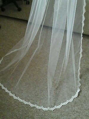 Bridal veil Ivory, chapel length. 97 ins Guipure Lace edge.Fully gathered