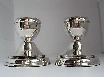 A pair of English hallmarked sterling silver dwarf candlesticks 1978 Broadway Co