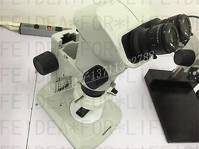 Olympus SZX7 Microscope with WHSZ10X-H/22 eyepieces + ACH 1X objective+Light