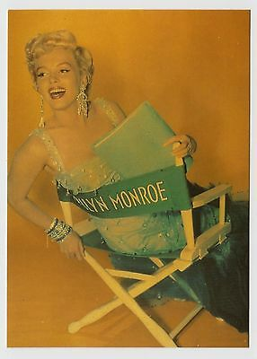 MODERN POSTCARD - Marilyn Monroe laughing in director's chair