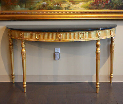 Stunning mahogany wood demi lune wall console in gold leaf with black marble top