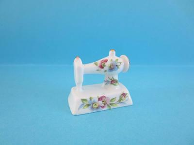 New Sewing Machine With Blue And Purple Flower Figurine With Gold Trim