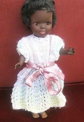Black vinyl doll 14 inches.Sleep eyes thick black rooted hair
