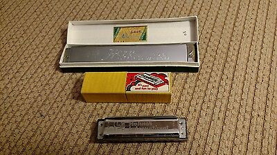 Two harmonicas, vintage with boxes