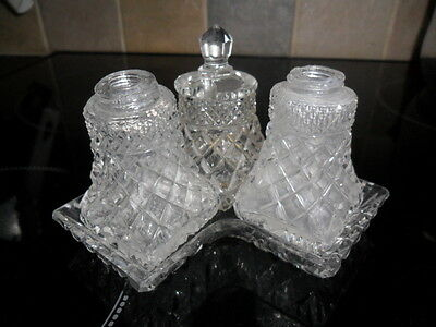 Glass cruet set, on glass tray, good condition, parts missing