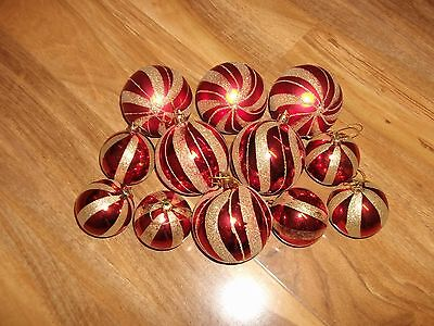 set of 12 red christmas tree baubles.