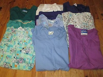 Lot of  8 scrub tops and 2 scrub bottoms