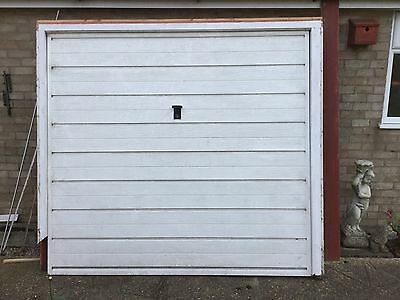 Used white up and over garage door 90 Inches Wide X 80 Inches High.