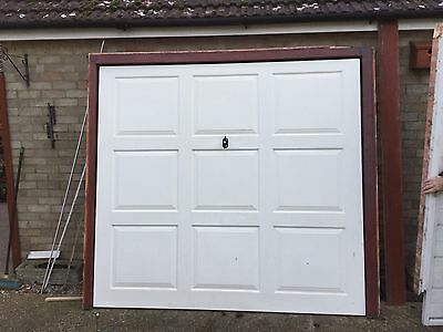 Used white Up And Over Garage Door. Fibreglass 90 Inches Wide X 80 Inches High.
