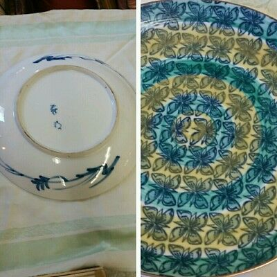 Large oriental pottery charger mid centery modern looking signed  by artist