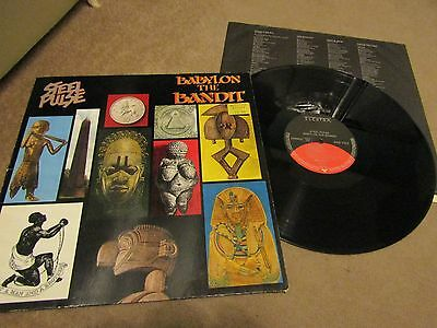 STEEL PULSE  LP VINYL 1985 BABYLON THE BANDIT 9 Track With Inner ELEKTRA 9604371