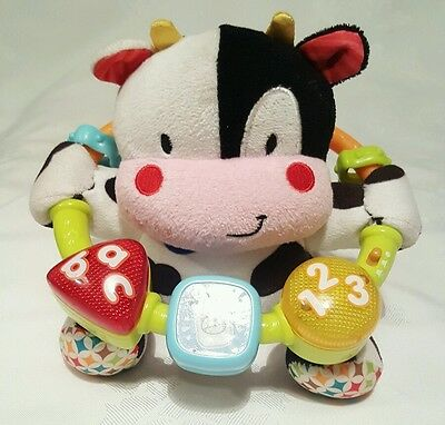 VTech Baby Musical Baby Cow Rattle, Soft Toy - Alphabet and Numbers