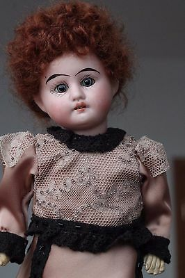 "Antique German Bisque doll with teeth (11"")"
