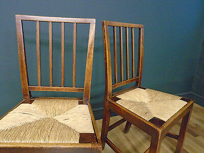 Pair of Antique Elm country chairs Hepplewhite style back with drop in rush seat