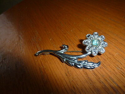 retro silver coloured flower brooch with shiny stones