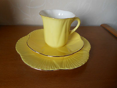 Shelley -  Dainty Shape Rare Buttercup Yellow Trio -Tall Cup Saucer & Side Plate