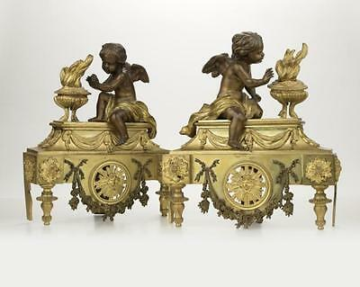 A pair of patinated and gilt-bronze chenets Lot 2164