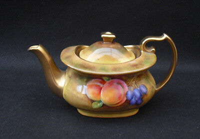 Worcester style small teapot with painterly fruit to the side and gilding pretty