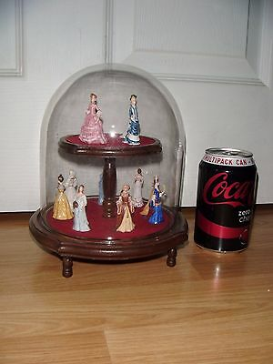 12 Miniature Ceramic Period Lady Figurines On Wooden Stand Under Glass Dome
