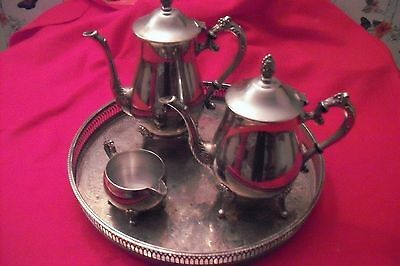 silver plated items coffee pot and tea pot plus others